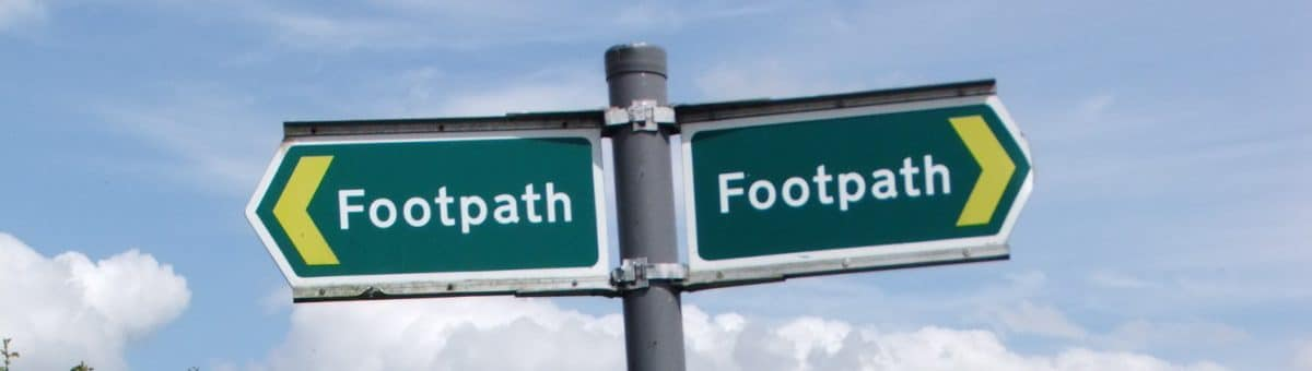 Picture of two footpath signs pointing in opposite directions